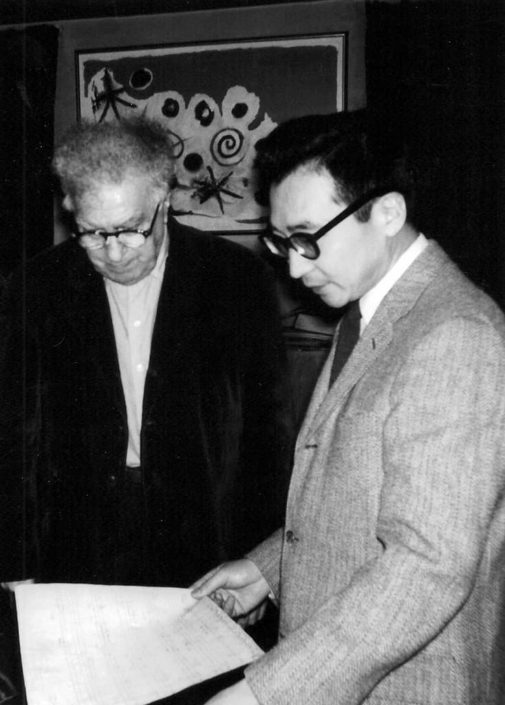 Chou Wen-chung and Edgard Varèse reviewing scores, New York City.