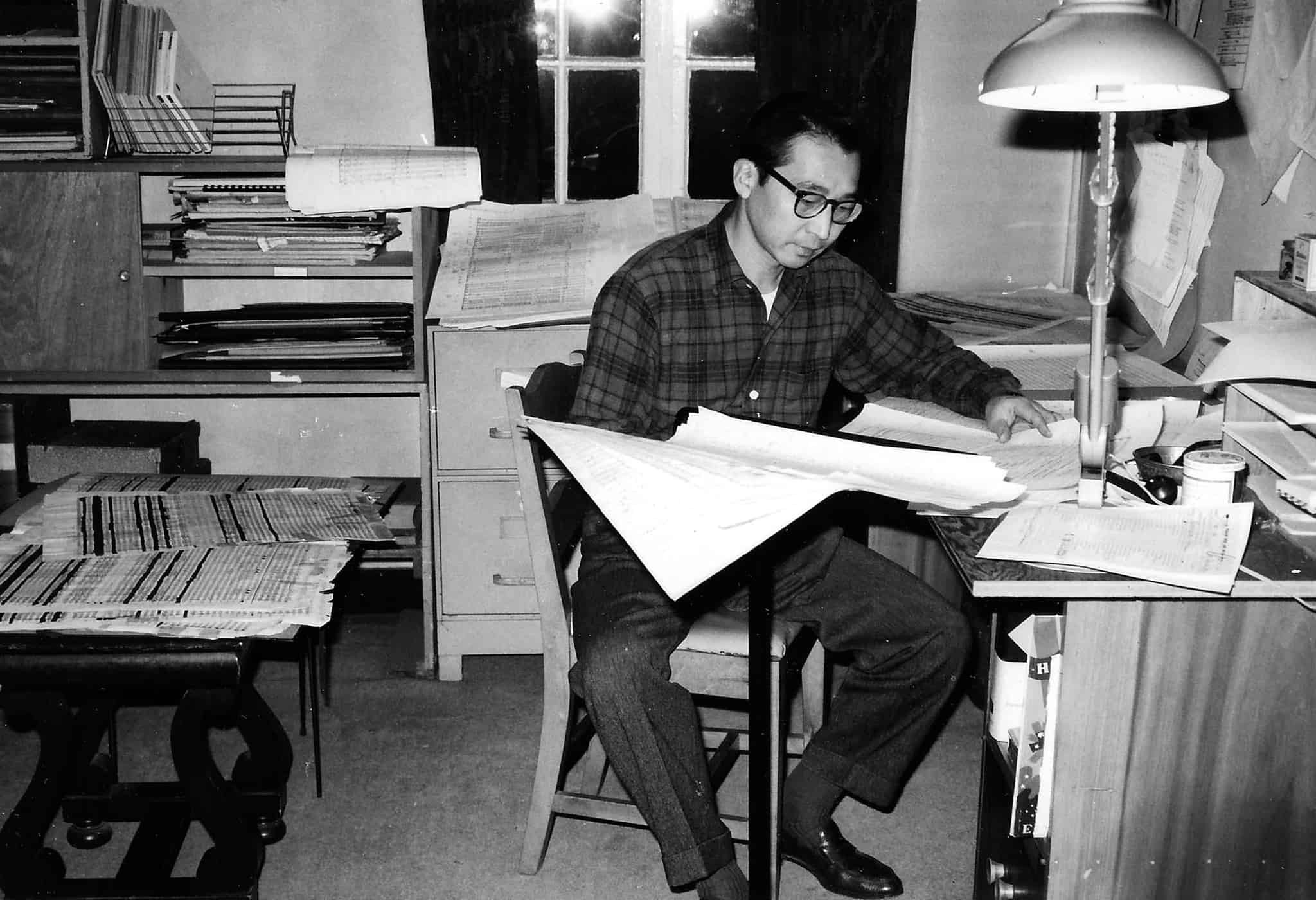 Chou Wen-chung working in Varèse's studio, New York City.